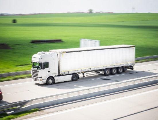 white-tir-truck-in-motion-driving-on-highway-picjumbo-com